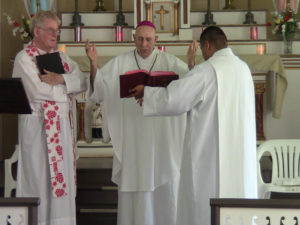 Father Patrick Killilea (left) was installed on July 11, 2012 as the pastor of Kalaupapa's St. Francis Church by Honolulu Bishop Larry Silva (center). Photo by Mark Miller.