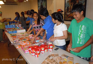 An annual project by the Youth Ministry of St. Damien Catholic Parish is the Sunshine Backpack Project