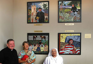 Sister Dorothy with the mosaic art that she created depiciting the life and work of Fr. Damien