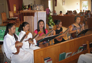 St. Damien's Youth Ministry ukulele group performing at a mass celebration